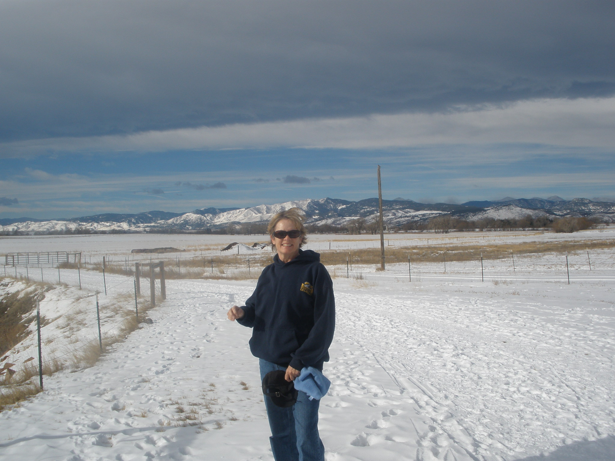 Lovely woman stands on a snowy trail