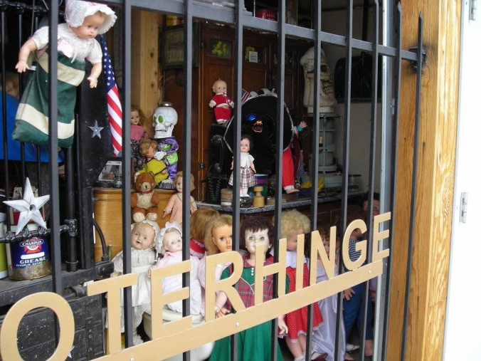 Old dolls behind bars in Mead, Colorado