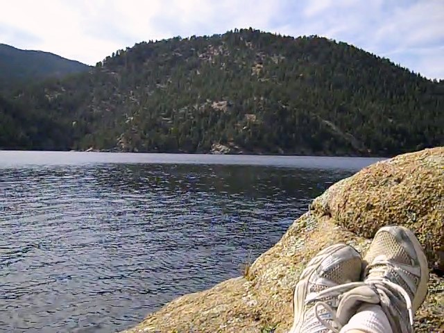 Taking a rest after hiking to mountain lake