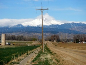 One pole on a dirt road in Mead Colorado