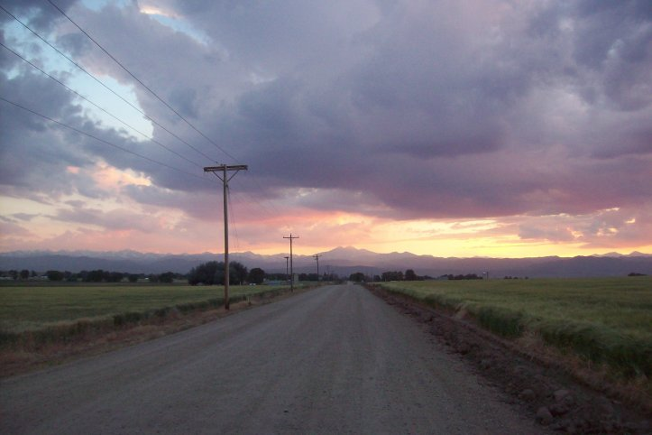 vast sky on dirt road in colorado