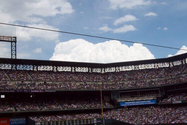 view of a big white cloud at rockies baseball game
