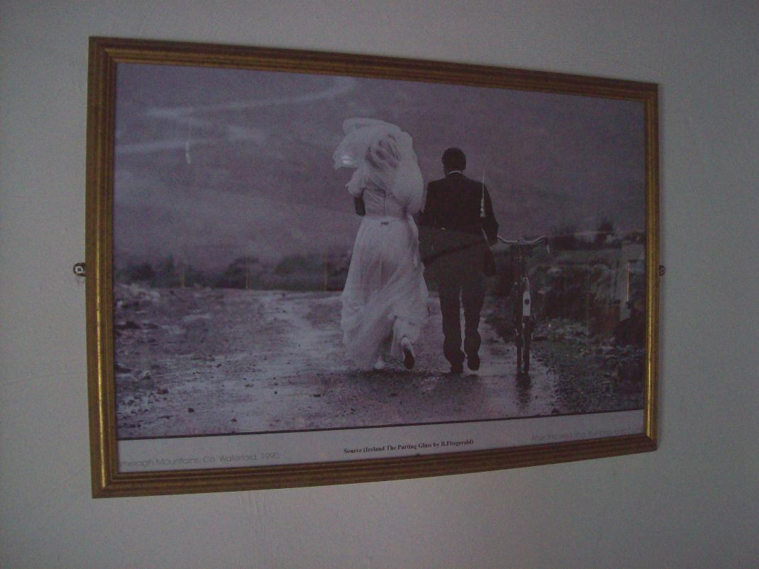 bride and groon walking with bicycle