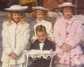 3 young sisters and one brother dressed up to attend a wedding