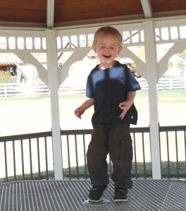 Three year old singing with his heart and soul on a table in the gazebo!