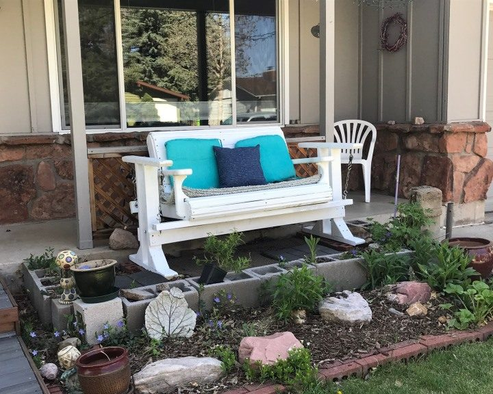 White chair on porch in Fort Collins, CO at HappilyafterRetirement.com