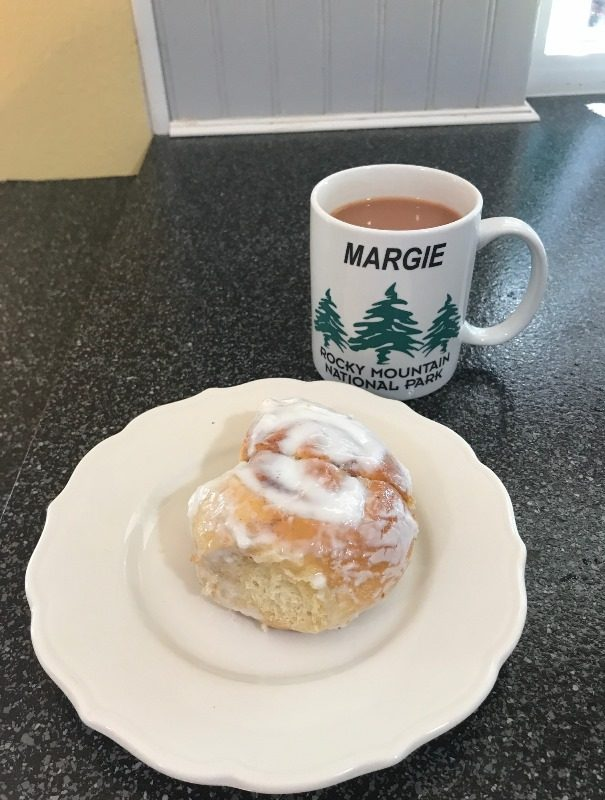 cup of tea and a cinnamon roll